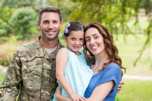 Soldier reunited with family on a sunny day